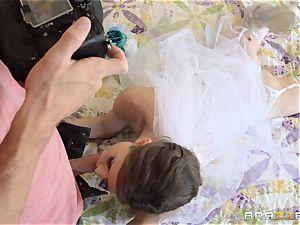 Jenni Lee nailing her wedding cameraman