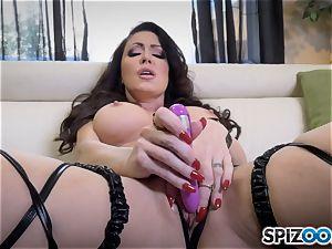 nasty Jessica Jaymes slips a fake penis in her wet minge