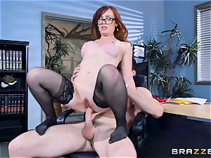 Dani Jensen playing with lollipop in the office