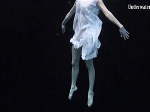 sandy-haired bombshell in the white dress