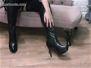 wonderful assistant slowly pulls on her leather hip shoes