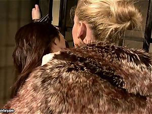 Kathia Nobili in fur covered jacket torturing a steamy stunner
