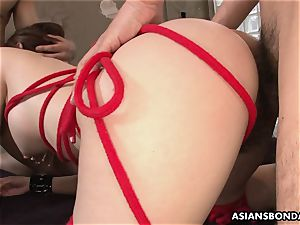 splashing asian is strapped up and used in a threesome