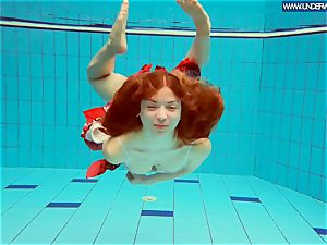 steamy polish red-haired swimming in the pool