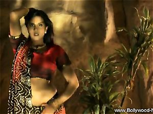 Indian dark haired Dance Gracefully