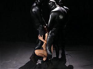 Asa Akira gets bukkake from three rubber clothed dudes